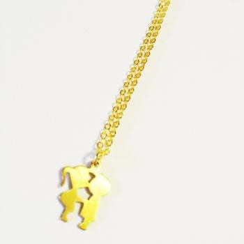 Vintage retro boy and girl kissing gold plated necklace :) Cute puppy lovers first pure love